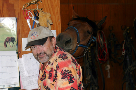 Les Vance and Mikey Relax in the tack room